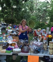 Mary Lou setting up the dollar table last year!