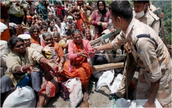 ITBP jawans distribute medicines to stranded pilgrims during Uttarakhand rescue operation.