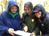Ms. Ingle and Ms. Zunguze review data that they collected on the salamander population this weekend at Purchase Knob.