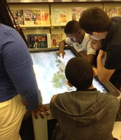 Students using the Promethean Table.