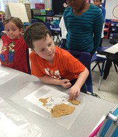 Students used wax paper as an overlay of a map to assist in creating their maps.