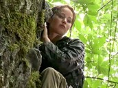 Katniss climbing a tree