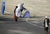 Taliban executing a woman.