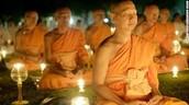 People Meditating to Buddha