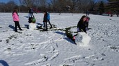 Making snow people at recess