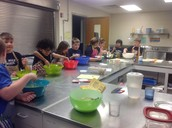 The students mixing the batter for the Spinach Quiche.