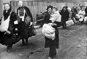 Families being deported in and out of the ghetto
