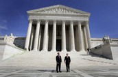 2 Justices In Front Of The Supreme Court