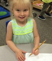 Working on writing letters and words!