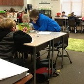 Parker and Luke working on multi-step word problems
