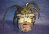 Student papier mache and found object mask