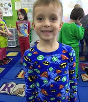 Garrett relaxing in his PJs during our snow day themed dress up day.
