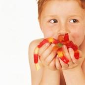 Happy kids eating gummies