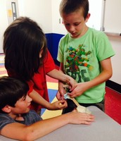 Gantt, Skyelar, and Tristan trying to get their catapult to work!