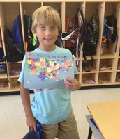 Hudson showing off his map skills!