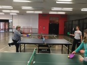 Mrs. Farwell and Chance face off at ping pong!