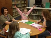 First grade students have fun talking about their data  with Mrs. Reischman!