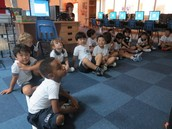 KG2 wait their turn at the Smartboard.