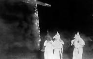 Lighting a cross on fire..