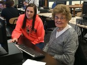 NHS students helping community members with technology