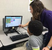Mrs. Falcon helps students learn about coding!