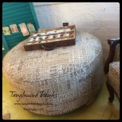 Round Upholstered Ottoman - $225