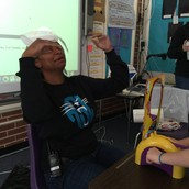 Mrs. Steele gets pied in the face during Mrs. Carlough's Class's Gold Coin Celebration