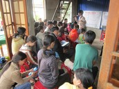 Khoa and his friend Doc, teaching doctrine to a church group.