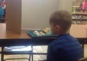 Eating Behind Cardboard Box