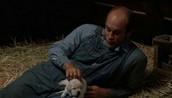 Lennie petting a dog