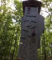 Emily made it to the top! Sam is climbing