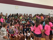 WEB Crew leaders and 6th graders eagerly listening.