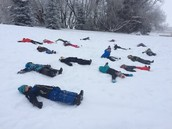 We go on a winter walk .. and they had to make snow angels!