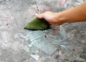 Sweep up broken glass
