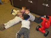 A sad Hudson being comforted by Will, John and Isaac.