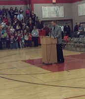 Mr. Spets speaking with the students during our Veteran's Day program.
