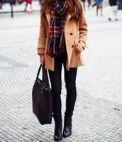 Girl Wearing Brown Jacket, Plaid Scarf, and Black Jeans and Boots