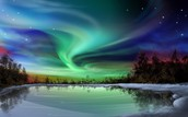 What is the actual cause of the Aurora Borealis?