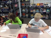 Breanna and Zach researching on Chromebooks