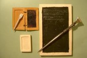 They used quill pens and wax tablets to write down notes.