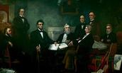 Abraham Lincoln writing the Emancipation Proclamation