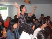 Lin worshiping in a Vietnamese church while visiting her family in Quang Ngai.
