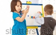 Kids playing with the magnetic board