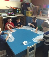 Practicing our letters in shaving cream.