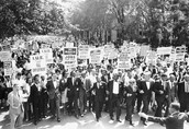 A march demanding equal pay between whites and blacks.