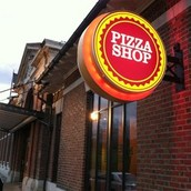 Come and eat pizza at are family style dinning pizza shop