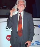 Dr. Martin Cooper holding the new DynaTAC