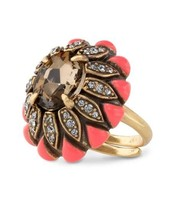 Strike the perfect balance for a cocktail ring that adds an instant pop of color to any look.