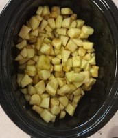 Apples in the slow cooker before being cooked..