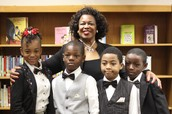Board President Dr. Thelma Dillard with Southfield students